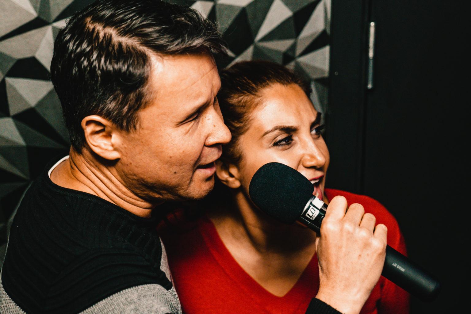 Two people singing at K Karaoke