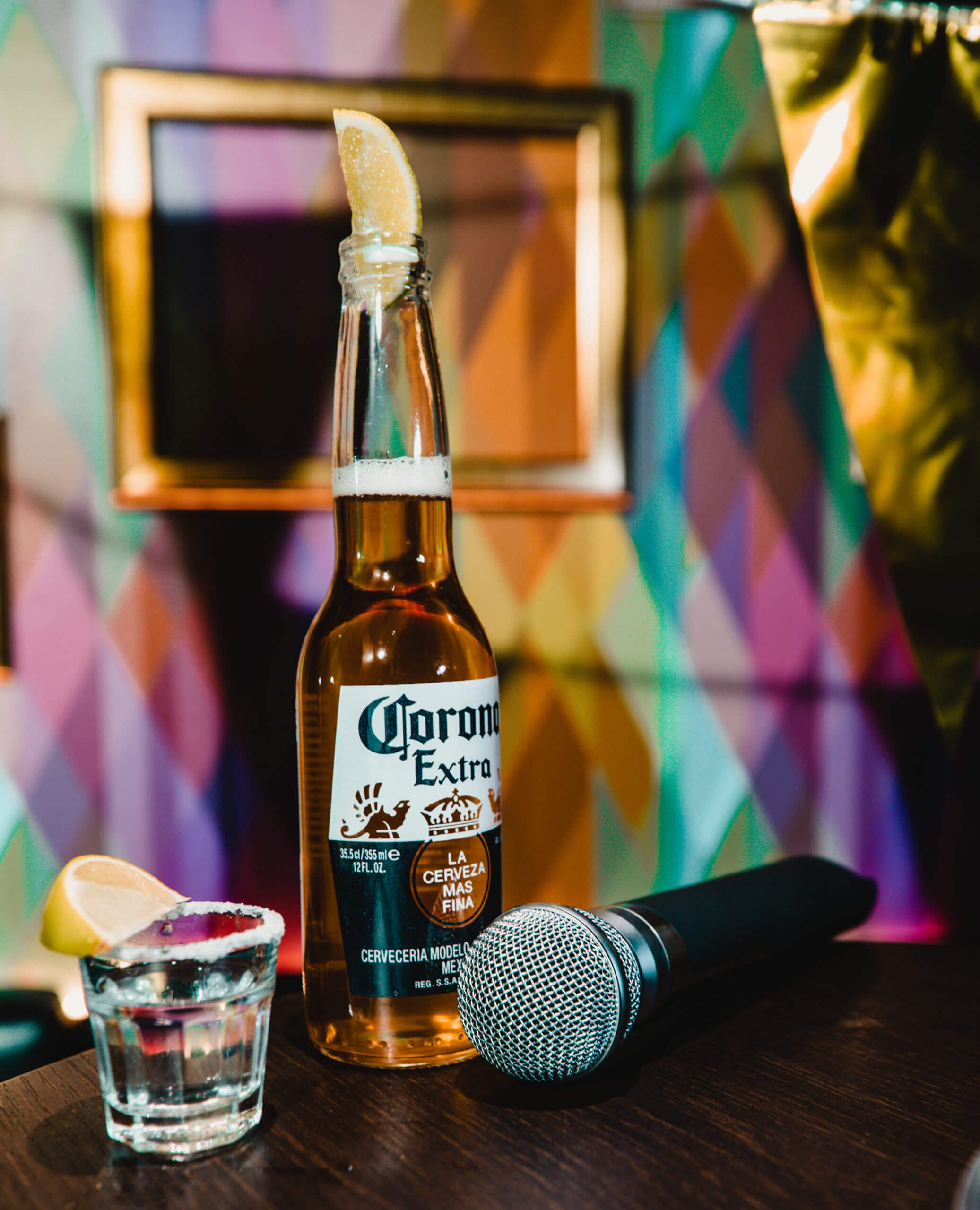 corona drink next to a microphone